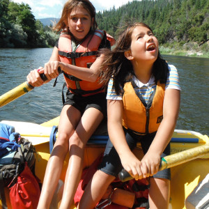 two kids in a raft